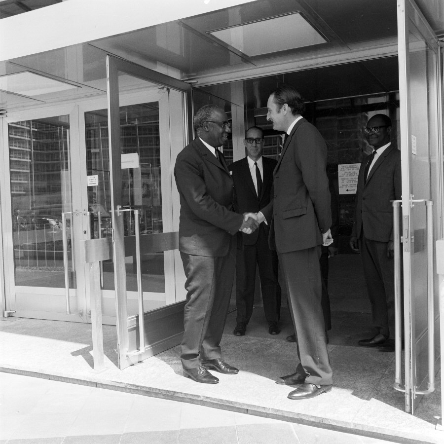 Handshake between H.E. Ambassador Aimé Raymond N'Thepe, Head of the Mission of Cameroon to the EC, on the left, and Jean-François Deniau, Member of the CEC in charge of External Trade and Financial Control. Date: 07/07/1970
