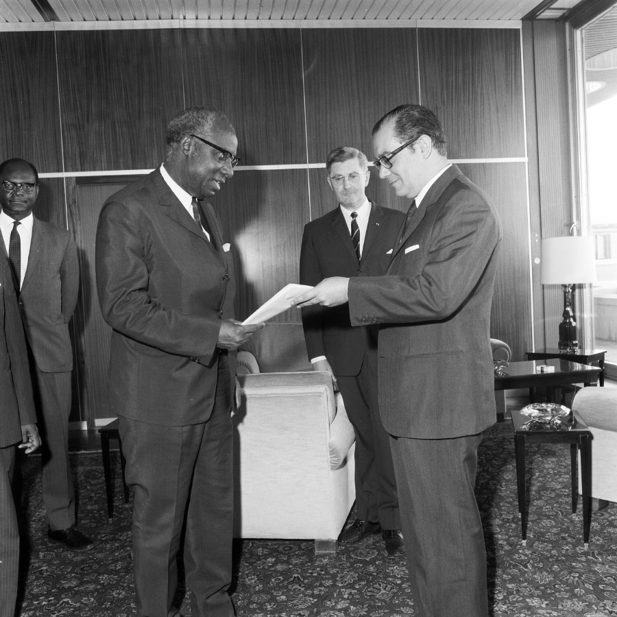 H.E. Ambassador Aimé Raymond N'Thepe, Head of the Mission of Cameroon to the EC, on the left, presenting his credentials to Franco Maria Malfatti. Date: 07/07/1970