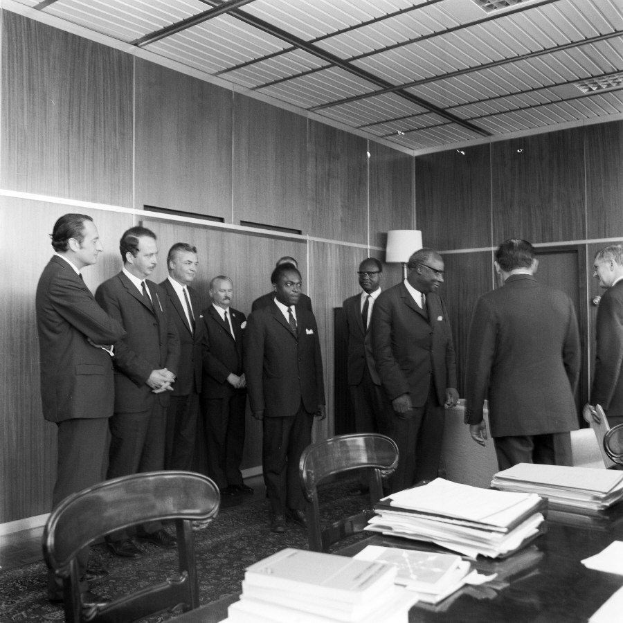 H.E. Ambassador Aimé Raymond N'Thepe, Head of the Mission of Cameroon to the EC, and Franco Maria Malfatti (2nd and 1st on the right). Date: 07/07/1970