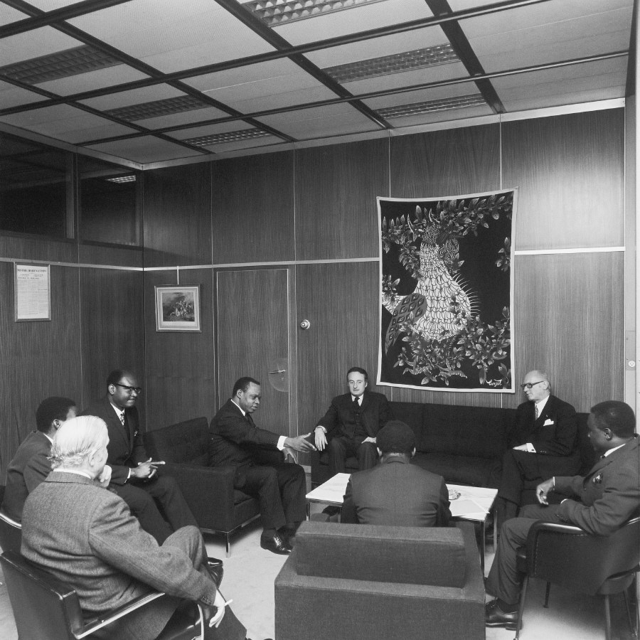 Meeting between H.E. Ambassador Simon Nko'o Etoungou, Head of Cameroon to the EC, 3 rd on the left, and Jean-François Deniau, 3rd on the right. Date: 26/01/1972