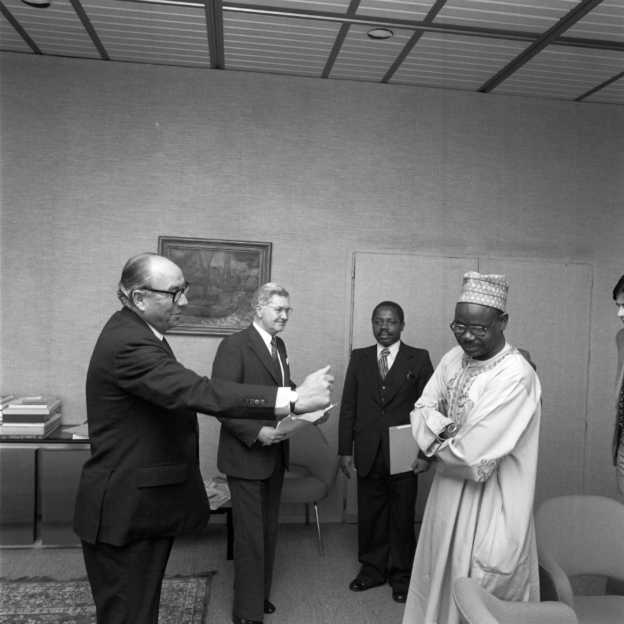 H.E. Ambassador Mahmoudou Haman Dicko, Head of the Mission of Cameroon to the EC, on the right, and Roy Jenkins with the credentials in his hand. Date: 24/07/1979